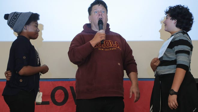 """Brent Scarpo runs through an exercise to facilitate a discussion about bullying with students at Raymond Cree Middle School's """"Love is Louder"""" spirit week, February 13, 2018."""