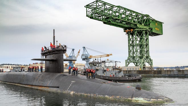 The USS Ohio arrives at Naval Base Kitsap-Bremerton to begin a Major Maintenance Period at PSNS in April 2017. The shipyard was recognized by the Department of Defense for its pace of maintenance, including breakinga record for removing the sub's mast and antenna. (U.S. Navy photo by Jeremy Moore/Released)