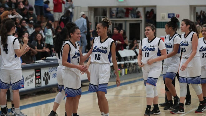 Cathedral City girls basketball celebrates after defeating Crean Lutheran, Thursday, February 15, 2018.