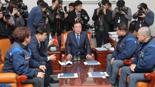 Chang Byung-Wan, center, head of the parliamentary trade and industry committee, meets with union leaders of embattled GM Korea Company at the National Assembly, Seoul, South Korea, February 19, 2018. GM has announced plans to close one of its four car assembly lines in South Korea.