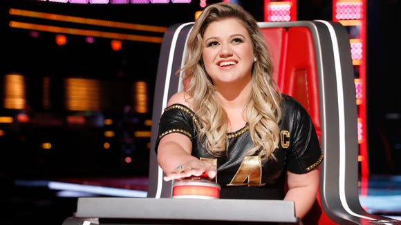 "Kelly Clarkson as a coach on ""The Voice."""