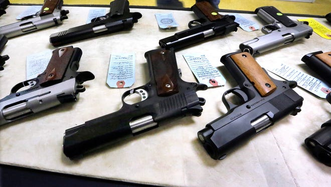 Handguns are displayed in this Associated Press file photo.