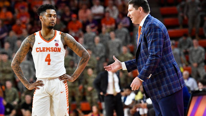Clemson head coach Brad Brownell speaks with Clemson guard Shelton Mitchell (4) during their game against Georgia Tech on Saturday, Feb. 24, 2018 at Clemson's Littlejohn Colosseum.