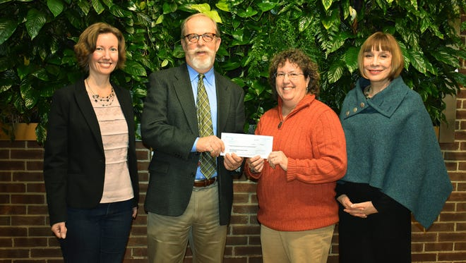 NORWESCAP CEO Terry Newhard (second from left) presents a check to establish the NORWESCAP Legacy Fund to RVCC Professor Karen Gutshall-Seidman (second from right). With them are professors Karen Gaffney (left) and Alicia Liss.