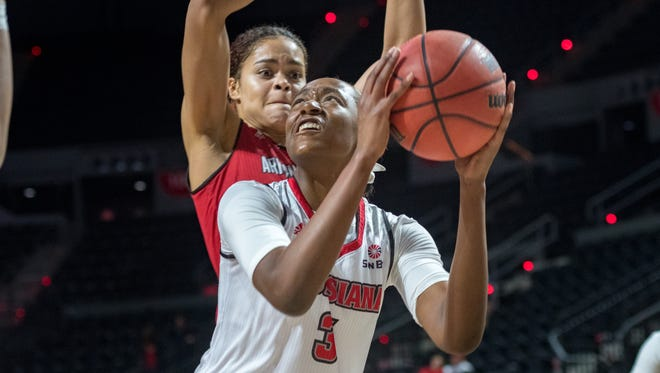 Ty'Reona Doucet takes a shot as the Louisiana Ragin' Cajuns take on the Arkansas State Red Wolves at the Cajundome. Thursday, March 1, 2018.