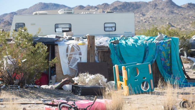 Sheriff's officials in San Bernardino County say a Joshua Tree homeless couple was raising their three malnourished children at this location in Joshua Tree for the past four years.
