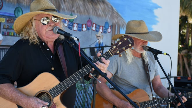 File: Jim Allen, left, plays music with his brother Merrill at a previous Harbor Arts & Music Festival.