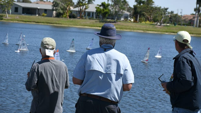 Skippers pilot their yachts from the shore. The Marco Island Model Yacht Club held their annual Mid-Winter R/C Laser Championship Regatta this weekend at Mackle Park, attracting radio-controlled sailboats from all over the country.