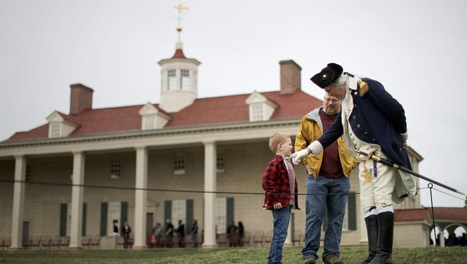 Dean Malissa (R) portrays President George Washington as he talks with vistors at the Mount Vernon Estate February 22, 2017 in Mount Vernon, Virginia.