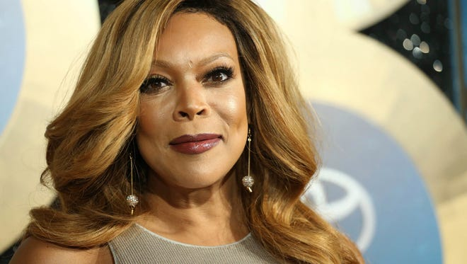 FILE - In this Nov. 7, 2014, file photo, TV talk show host Wendy Williams arrives during the 2014 Soul Train Awards in Las Vegas. Williams, is taking three weeks off on doctor's orders. She said Wednesday, Feb. 21, 2018, her doctor told her to take the break to deal with her Grave's Disease and hyperthyroidism. Reruns will air in her absence.  (Photo by Omar Vega/Invision/AP, File)