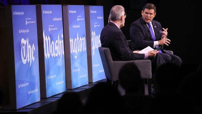 """Bret Baier, right, chief political anchor at Fox News, speaks with other journalists at a Jan. 23 conference titled """"Americans and the Media: Sorting Fact from Fake News"""" in Washington, D.C."""