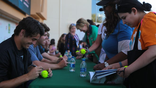 """Taylor Fritz and other """"Next Generation"""" ATP players sign autographs after the BNP Paribas Open men's draw, Tuesday, March 6, 2018."""