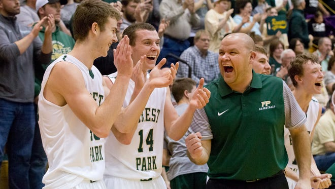 Forest Park's Collin Hochgesang, left, Daniel Lusk and head coach Jeff Litherland celebrate the Class 2A regional win earlier this year. Sarah Ann Jump/The Herald
