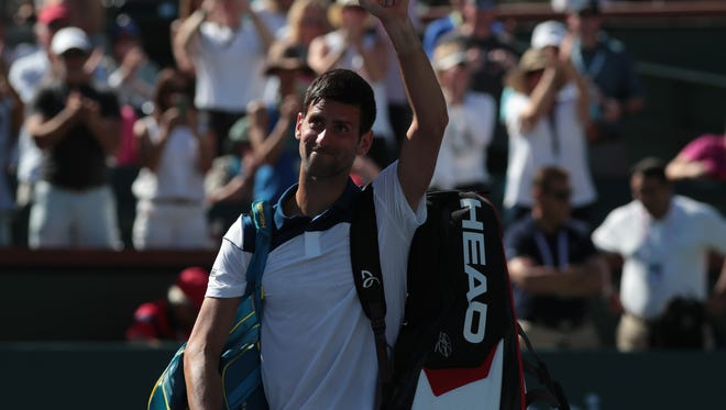 Novak Djokovic waves goodbye to fans after being defeated by Taro Daniel at the BNP Paribas Open, Sunday, March 11, 2018.