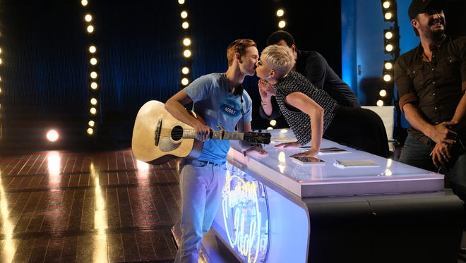 Contestant Benjamin Glaze was just going to kiss Katy Perry's cheek, but the singer turned to peck him on the lips.