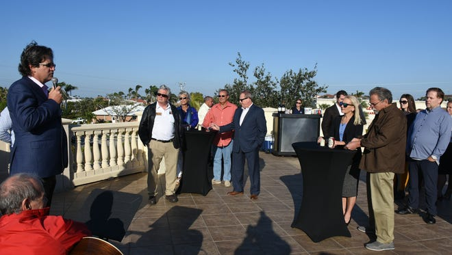 Naples Daily News publisher Bill Barker speaks, thanking the Marco community. The Marco Island Area Chamber of Commerce and the Marco Eagle held a reception and open house Wednesday afternoon to celebrate 50 years of the Eagle, and christen the paper's new office in the Mutual of Omaha Bank Building.