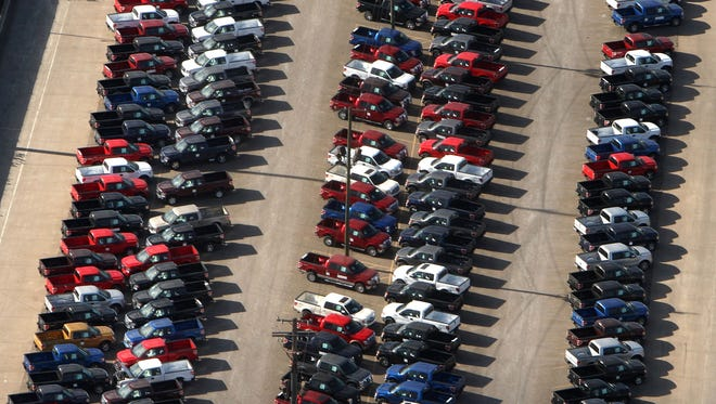 2009 Ford F-150 trucks are parked in a lot before being shipped in November 2008 in Detroit.