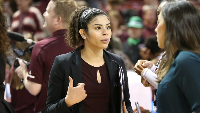 MSU student assistant coach Dominique Dillingham talks with coaches following the game.. Mississippi State played Nicholls in the first round of the NCAA Women's basketball tournament at Humphrey Coliseum on Saturday, March 17, 2018. Photo by Keith Warren