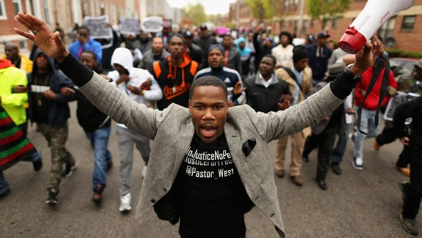 Hundreds of demonstrators march toward the ...