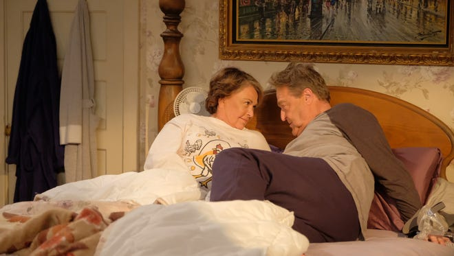 "Roseanne (Roseanne Barr) and Dan (John Goodman) — He's not dead! — chat in bed in the season premiere of ABC's revival of the hit comedy ""Roseanne."""