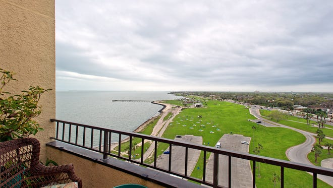 The view from the living area balcony takes in bay, city and Cole Park views