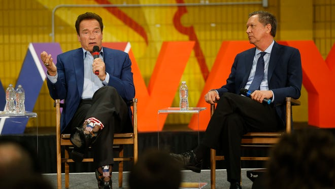 Former California Gov. Arnold Schwarzenegger, left, and Ohio Gov. John Kasich, participate in the first New Way California Summit, a political committee eager to reshape the state GOP, at the Hollenbeck Youth Center in Los Angeles on Wednesday.