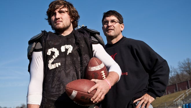 Gabe Dean, left, is the quarterback for the Lowell high school varsity football team and his uncle, Noel Dean, right, is the head coach.  (Adam Bird | Special to The Detroit Free Press)