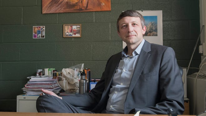 Principal Elijah Hawkes sits at his desk in Randolph Union High School on Thursday, March 22, 2018.