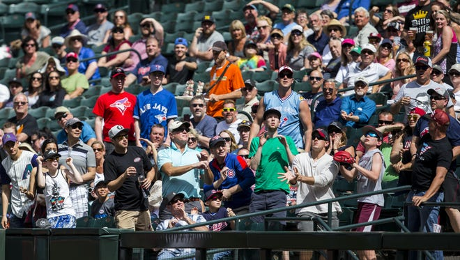 Fans look out for an Indians' fly ball in the 3rd inning of the Diamondbacks' last spring training game on Tuesday, Mar. 27, 2018 at Chase Field in Phoenix.