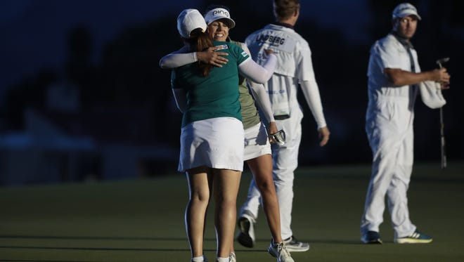 Inbee Park and Pernilla Lindberg embrace after they both got a par in the fourth playoff round of the ANA Inspiration final, Sunday, April 1, 2018.