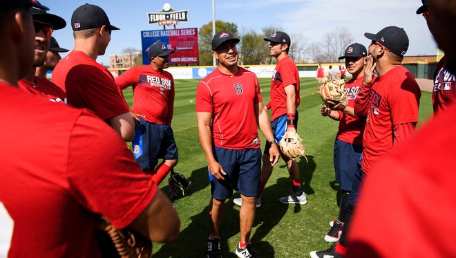 Greenville Drive manager  Iggy Suarez, middle, speaks with his players during practice at Fluor Field on Wednesday, April 4, 2018.