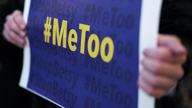 "WASHINGTON, DC - JANUARY 25:  An activist holds a #MeToo sign during a news conference on a Title IX lawsuit outside the Department of Education January 25, 2018 in Washington, DC. Anti-sexual harassment groups held a news conference to announce a ""landmark lawsuit against the Trump Administration over Title IX"" and the ""unconstitutional Title IX policy harming student survivors of sexual violence and harassment."""