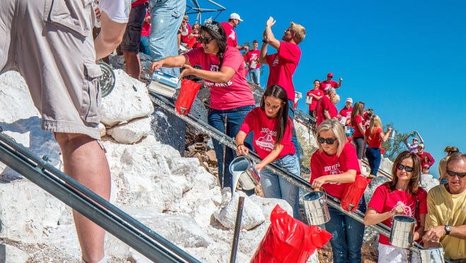 "Dixie State University students and community members work together to whitewash the ""D"" on Black Hill during D-Week festivities. The ""D"" will receive its annual coat of lime on Saturday, April 14, when students and community members participate in the whitewashing tradition."