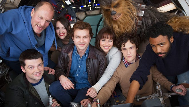 Alden Ehrenreich, center, and the rest of the cast of 'Solo: A Star Wars Story,' pose in July 2017 with the original directors of the Han Solo film, which was eventually handed off to Ron Howard to finish.