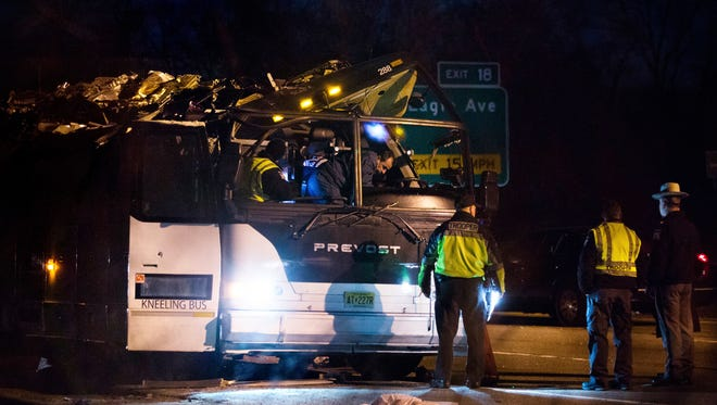 A bus that was carrying teenage passengers sits on the side of a highway after it hit an overpass on the Southern State Parkway in Lakeview, N.Y., Monday, April 9, 2018.