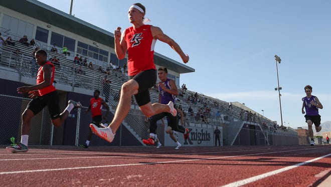 Cole Cruz pulls ahead to win the boys 100 meter race for Palm Springs during their meet at Shadow Hills, April 11, 2018