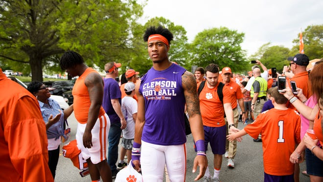 Clemson fans meet the team during the Tiger Walk before the spring 2018 football game on Saturday, April 14, 2018.