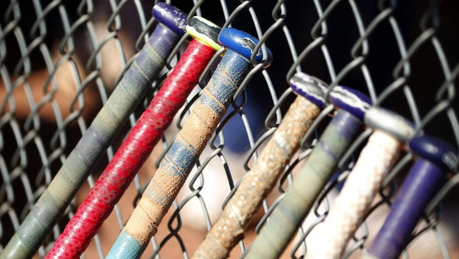 Bats line the dugout during a high school softball game at Mountain Pointe on March 23, 2018.