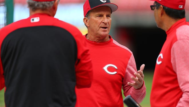 T. LOUIS, MO - APRIL 20: Interim manager Jim Riggleman #35 of the Cincinnati Reds visits with his bench coach Pat Kelly (left) and hitting coach Tony Jaramillo in batting practice prior to playing against the St. Louis Cardinals at Busch Stadium on April 20, 2018 in St. Louis, Missouri. (Photo by Dilip Vishwanat/Getty Images)