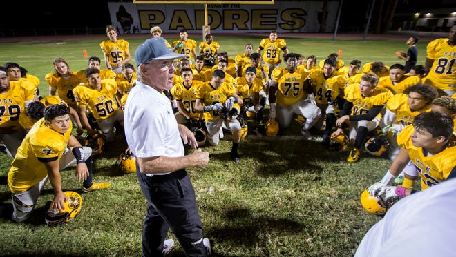 Marcos de Niza head coach Paul Moro speaks to his team after a game against Cactus Shadows on Friday, October 7, 2016 in Tempe, Arizona.