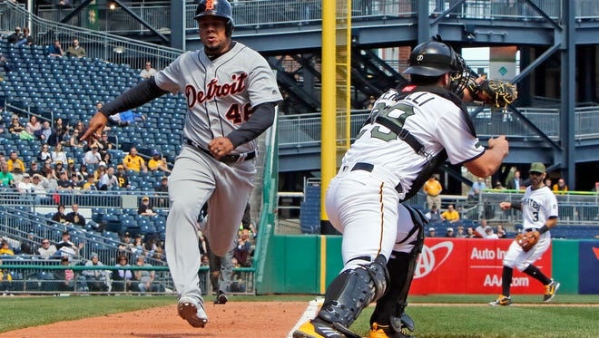 Pirates catcher Francisco Cervelli touches home on a force out in the ninth inning against Tigers pinch hitter Jeimer Candelario during the Tigers' 1-0 loss on Thursday, April 26, 2018, in Pittsburgh.