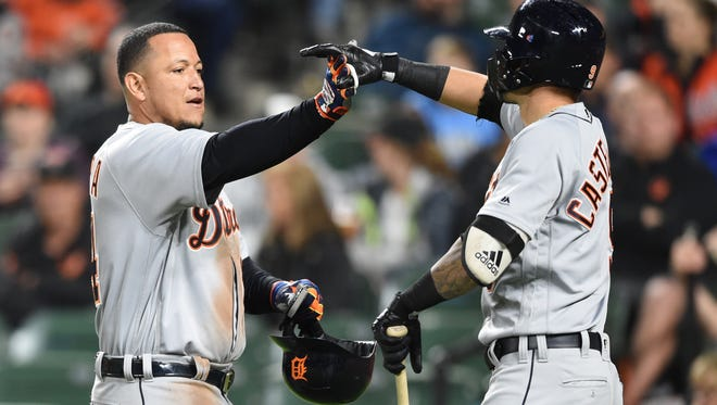 Miguel Cabrera of the Detroit Tigers celebrates a three-run home run in the second inning with Nick Castellanos.