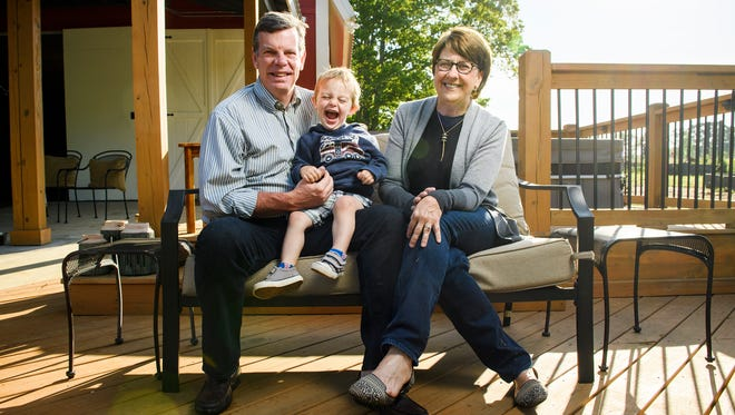 Donna and Jeff Millard pose for a portrait at their remodeled home with their grandson Owen, 2, in Simpsonville on Tuesday, May 2, 2018.