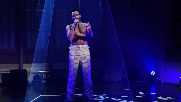 Donald Glover took off his shirt as Childish Gambino