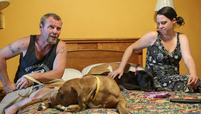 Bryan Hensley and Carene Riale are reunited with their dogs after being seperated from them when the homeless were forced to move out of the large encampment at Dillon Rd and Hwy 86 earlier this month.