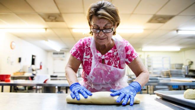 Maria Lalas makes sweet bread at Saint George Greek Orthodox Church on Monday, May 7, 2018.