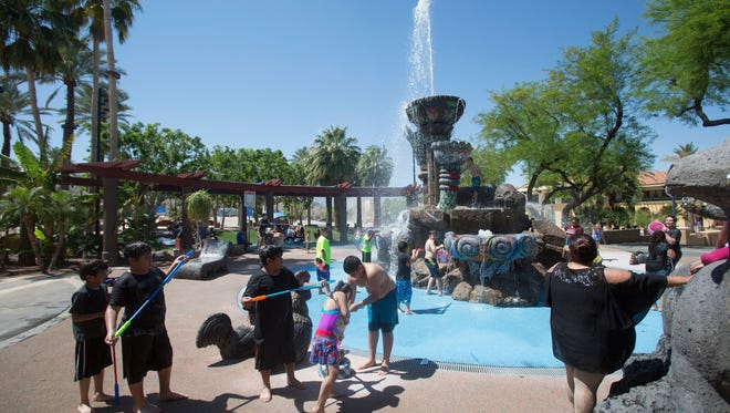 """Children play at the """"Fountain of Life"""" at Cathedral City Civic Center on April 12, 2017."""