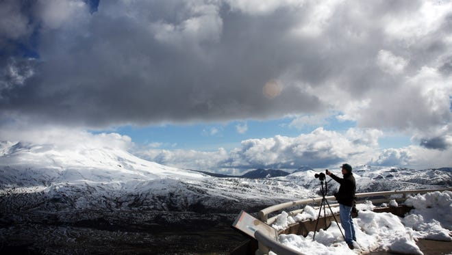 Mount St. Helens, covered in snow, is viewed from the Johnston Ridge Observatory, five miles from the crater, in 2010.