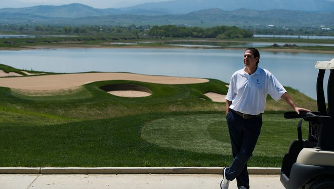 Stephen Arendt, the head golf professional at the new TPC of Colorado course near Berthoud, stands near the first hole May 15 while discussing the course's unique features.