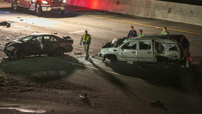 In this photo from Tuesday, California Highway Patrol officers investigate the scene of a multi-car crash on Interstate 880 in Fremont. Three people were killed in a multi-car crash that closed several lanes of a major San Francisco Bay highway and officials say the driver suspected of causing it was under the influence of marijuana.